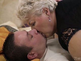 Chunky mature blonde whore in black small-clothes Astrid gives quite nice BJ
