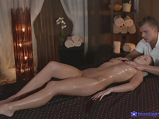 Oiled cutie gets her pussy massaged and fucked with a large dick